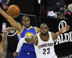 The Cleveland Cavaliers' LeBron James looks for the pass while being guarded by the Golden State Warriors' Andre Iguodala in the first quarter during Game 4 of the NBA Finals at Quicken Loans Arena in Cleveland on Friday, June 9, 2017. (Photo by Leah Klafczynski/Akron Beacon Journal/TNS) *** Please Use Credit from Credit Field ***