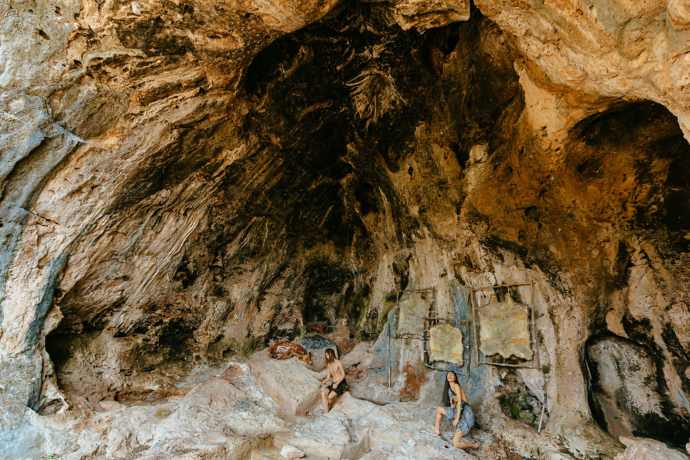 Mannequins used to depict a pre-historic human settlement are seen in a cave in the Nahal Me'arot Nature Reserve, or Wadi el-Mughara Caves, situated on the western slopes of Mount Carmel  in northern Israel. The site includes the caves of Tabun, Jamal, el-Wad and Skhul. These caves represent at least 500,000 years of human evolution and pre-historic human habitation, demonstrating the unique existence of both Neanderthals and Early Anatomically Modern Humans