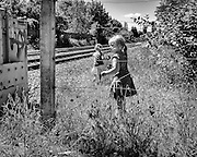 Ghent, Belgium, 14 may 2011, Girls picking flowers along the railroad