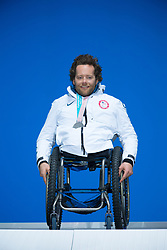 March 17, 2018 - Pyeongchang, South Korea - Tyler Walker of the US with his new silver medal from the Sitting Slalom event during a Medal Ceremony Saturday, March 17, 2018 at the Pyeongchang Medals Plaza at the Pyeongchang Winter Paralympic Games. Photo by Mark Reis (Credit Image: © Mark Reis via ZUMA Wire)
