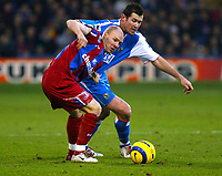Fotball<br /> Premier League England 2004/2005<br /> Foto: SBI/Digitalsport<br /> NORWAY ONLY<br /> <br /> Crystal Palace v Blackburn Rovers<br /> Barclays Premiership. 11/12/2004<br /> <br /> Andy Johnson of Palace tussles for the ball with Brett Emerton of Blackburn Rovers.