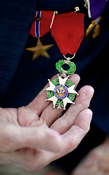 06 June 2014. The National WWII Museum, New Orleans, Lousiana. <br /> Staff Sgt Randy Richmond, a WWII veteran shows of his Bronze Star, French Legion of Honor and Purple Heart medals.<br /> Photo; Charlie Varley/varleypix.com