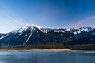 Mount Cheam (left) and Mount Archibald from the Fraser River near Agassiz, British Columbia, Canada