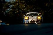 Anthony Pons, Raymond Narac and Nicolas Armindo, IMSA Performance Matmut (GTE-AM) Porsche 911 GT3 RSR, Petit Le Mans. Oct 18-20, 2012. © Jamey Price
