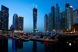 Evening view of high rise office and apartment towers at Dubai Marina, United Arab Emirates, UAE