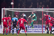 Woking goalkeeper Craig Ross (1) makes an important save during the The FA Cup 2nd round match between Swindon Town and Woking at the County Ground, Swindon, England on 2 December 2018.