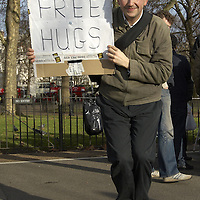 Man holding a Free Hug sign at the Speaker's corner, Hyde Park, London
