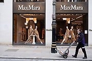 With very few people out and about, Bond Street is virtually empty with all shops, like here outside the Max Mara store, closed as the national coronavirus lockdown three continues on 3rd March 2021 in London, United Kingdom. With the roadmap for coming out of the lockdown has been laid out, this nationwide lockdown continues to advise all citizens to follow the message to stay at home, protect the NHS and save lives, and the streets of the capital are quiet and empty of normal numbers of people.