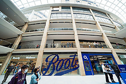 Edinburgh, Scotland, UK. 24 June 2021. First images of the new St James Quarter which opened this morning in Edinburgh. The large retail and residential complex replaced the St James Centre which occupied the site for many years. Pic; New Boots store inside mall. Iain Masterton/Alamy Live News