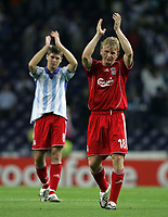 Photo: Paul Thomas.<br /> Porto v Liverpool. UEFA Champions League Group A. 18/09/2007.<br /> <br /> Goal scorer Dirk Kuyt (R) and Steven Gerrard of Liverpool thank their travellig fans.