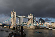 Weeks before the UKs Brexit from the European Union on 31st January 2020, a wide cityscape of Tower Bridge and the City of London, the capitals financial district, all under a darkening sky, on 17th January 2020, in London, England.