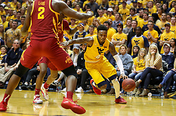 Feb 24, 2018; Morgantown, WV, USA; West Virginia Mountaineers guard Daxter Miles Jr. (4) drives towards the basket during the second half against the Iowa State Cyclones at WVU Coliseum. Mandatory Credit: Ben Queen-USA TODAY Sports