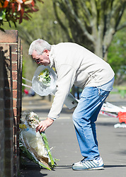 April 17, 2018 - London, England, United Kingdom - A man places flowers near the site of stabbing in Forest Gate. A teenager has been stabbed to death in an east London street bringing the capital's death toll this year up to 60.  (Credit Image: © Gustavo Valiente/i-Images via ZUMA Press)