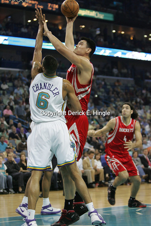 Yao Ming #11 for Houston shoots as Tyson Chandler #6 for the Hornets defends on February 22, 2008 at the New Orleans Arena in New Orleans, Louisiana. The New Orleans Hornets lost to the Houston Rockets 100-80..