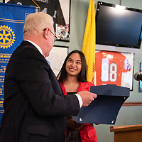 Jay McCollum, left, presents McKinley Academy High School Senior Marianne Lachica with a Senior of the Month certificate at the Rotary Club's Senior of the Month luncheon, Wednesday, Feb. 20 at Sammy C's in Gallup.