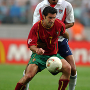 USA's Anthony Sanneh closely watches Portugal's Luis Figo
