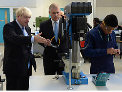 The Duke of York & Boris Johnson College Opening.<br /> (L-R) The Mayor of London Boris Johnson with HRH The Duke of York talk to students during the opening of the Royal Greenwich University Technical College. The new regional academy will develop the skills of 14-19 year olds in engineering and construction, alongside their core academic education, London, United Kingdom. Thursday, 24th October 2013. Picture by Andrew Parsons / i-Images