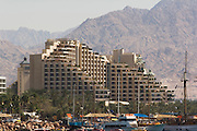 Dan Hotel, Eilat, Israel, with boats and yachts in the foreground, Eilat, pop. 55,000, is Israel's southernmost city in the Southern District of Israel. Adjacent to the Egyptian city of Taba and Jordanian port city of Aqaba, Eilat is located at the northern tip of the Gulf of Aqaba, which is the eastern sleeve of the Red Sea.