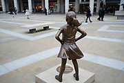 Fearless Girl Statue by sculptor Kristen Visbal in London, England, United Kingdom. The Fearless Girl, which has also been referred to as the Defiant Girl statue, originally situated on Wall Street in 2017, standing facing down the charging bull statue, has been installed in London to mark international women's day. The bronze statue has been installed in Paternoster Square.