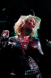 Kim Wilde steps out of the her TV Gardening clothes and Back on Stage to Tour with<br /><br />Steve Starnge (Visage)<br />Claire Grogan (Altered Images)<br />The Belle Stars<br />Dollar<br />Kim Wilde<br />The Human League<br />Play on the Here and Now  Christmas Party Tour at Sheffields Hallam FM Arena Friday 13th December 2002<br /><br />[#Beginning of Shooting Data Section]<br />Nikon D1 <br />2002/12/13 22:54:07.1<br />JPEG (8-bit) Fine<br />Image Size:  2000 x 1312<br />Color<br />Lens: 80-200mm f/2.8-2.8<br />Focal Length: 80mm<br />Exposure Mode: Manual<br />Metering Mode: Spot<br />1/200 sec - f/2.8<br />Exposure Comp.: 0 EV<br />Sensitivity: ISO 800<br />White Balance: Auto<br />AF Mode: AF-S<br />Tone Comp: Normal<br />Flash Sync Mode: Not Attached<br />Color Mode: <br />Hue Adjustment: <br />Sharpening: Normal<br />Noise Reduction: <br />Image Comment: <br />[#End of Shooting Data Section]
