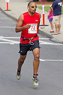 Middletown, New York - A man races for the finish line during the 2012 Run 4 Downtown road race on Saturday, Aug. 18, 2012.