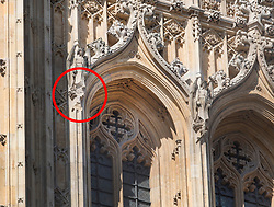 © Licensed to London News Pictures. 19/04/2018.  A sculpture of an angel (circled) has a piece missing after it became loose and fell. Black Rod's Entrance and Garden have been closed after a chunk of masonry fell from Victoria Tower at Parliament. London, UK. Photo credit: Peter Macdiarmid/LNP