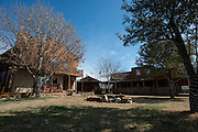 JUSTIN, TX - FEBRUARY 4, 2014: A general view of the home (left) and saloon (right) for sale at 1780 Strader Road for the What You Get column. (Cooper Neill / for The New York Times)