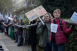 © licensed to London News Pictures. London, UK 01/12/2012. Protesters in London building a 200 metre ?oil pipeline? from the Canadian High Commission to the US Embassy in Grosvenor Square to protest against the Keystone XL pipeline being built to transport Canadian Tar Sands oil to the US. Photo credit: Tolga Akmen/LNP