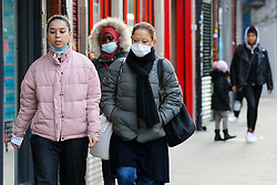 © Licensed to London News Pictures. 06/01/2021. London, UK. Women wearing protective face coverings in north London. The Met Police have warned that members of public who break coronavirus lockdown restrictions by refusing to wear a mask 'can expect to be fined'.  Prime Minister Boris Johnson announced on Monday 4 January 2021 that England will go into third national lockdown after the mutated variant of the SARS-Cov-2 virus continues to spread around the country, and asked everyone to 'stay at home' and only leave for the specific reasons, until mid-February. Photo credit: Dinendra Haria/LNP