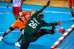 The Dutch handball player Patrick Miedema and Yunus Ozmusul in action during the European Championship qualifying match against Turkey in the Topsport Center Almere.