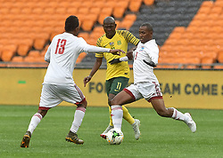 South Africa: Johannesburg: Bafana Bafana player Aubrey Modiba battle for the ball with Seychelles players Colin Esthe(L)r and Colin Bibi(R) during the Africa Cup Of Nations qualifiers at FNB stadium, Gauteng.<br />Picture: Itumeleng English/African News Agency (ANA)