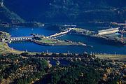 USA, Oregon,  Washington, Columbia River Gorge, aerial landscape of Bonneville Dam, tug is pushing a barge towards the locks.
