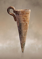Minoan stone conical rhython with carved ring decoration, Zakros 1500-1400 BC; Heraklion Archaeological  Museum. .<br /> <br /> If you prefer to buy from our ALAMY PHOTO LIBRARY  Collection visit : https://www.alamy.com/portfolio/paul-williams-funkystock/minoan-art-artefacts.html . Type -   Heraklion   - into the LOWER SEARCH WITHIN GALLERY box. Refine search by adding background colour, place, museum etc<br /> <br /> Visit our MINOAN ART PHOTO COLLECTIONS for more photos to download  as wall art prints https://funkystock.photoshelter.com/gallery-collection/Ancient-Minoans-Art-Artefacts-Antiquities-Historic-Places-Pictures-Images-of/C0000ricT2SU_M9w