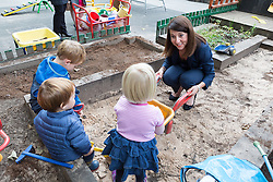 © Licensed to London News Pictures. 08/09/2015. London, UK. Labour party leadership candidate, LIZ KENDALL MP plays in the sandpit during her visit to Clapham Manor Children's Centre in south west London. Photo credit : Vickie Flores/LNP