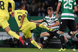 February 14, 2019 - Lisbon, Portugal - Villarreal's forward Carlos Bacca (L) vies with Sporting's midfielder Miguel Luis from Portugal during the UEFA Europa League Round of 32 First Leg football match Sporting CP vs Villarreal CF at Alvalade stadium in Lisbon, Portugal on February 14, 2019. (Credit Image: © Pedro Fiuza/NurPhoto via ZUMA Press)