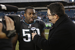 Philadelphia Eagles outside linebacker Trent Cole #58 is intervened by Tony Siragusa of Fox Sports after the NFL game between the Arizona Cardinals and the Philadelphia Eagles on Sunday, December 1st 2013 in Philadelphia. The Eagles won 24-21. (Photo by Brian Garfinkel)