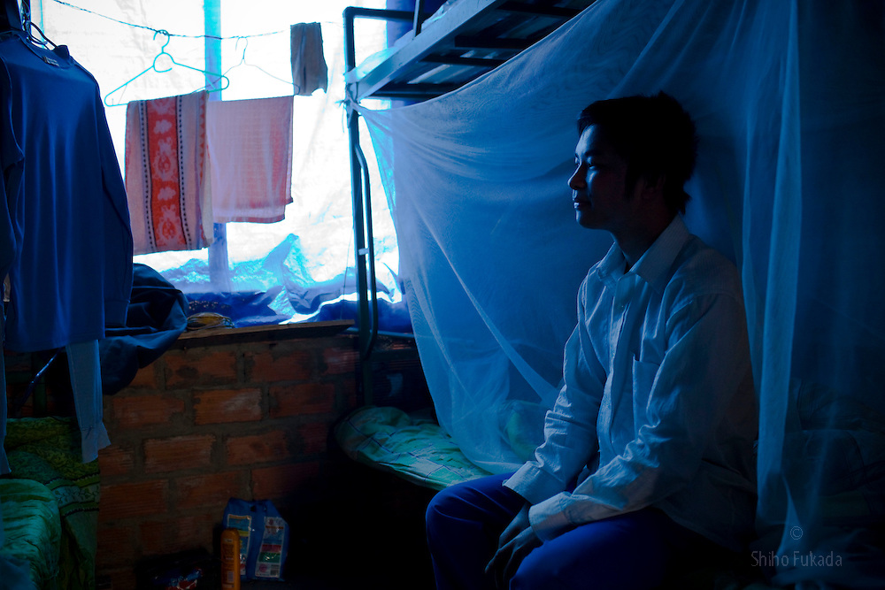 A Chinese worker of the Haiphong Thermal Power Plant construction site rests at his dorm in Trung Son, Vietnam, Nov. 22, 2009. At the construction site here, a few miles northeast of the port city of Haiphong, .an entire Chinese world has sprung up, including four walled dormitory compounds for the Chinese workers, restaurants with Chinese signs advertising dumplings and fried rice, and currency exchange shops.