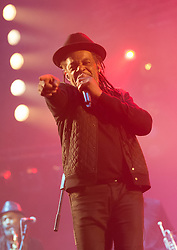 © Licensed to London News Pictures. 11/06/2015. Newport, UK.   UB40 performing live at Isle of Wight Festival 2015, Day 1 Thursday.   In this picture - Astro.Photo credit : Richard Isaac/LNP