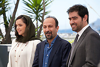 Taraneh Alidoosti, director Asghar Farhadi and Shahab Hosseini at The Salesman (Forushande) film photo call at the 69th Cannes Film Festival Friday 20th May 2016, Cannes, France. Photography: Doreen Kennedy