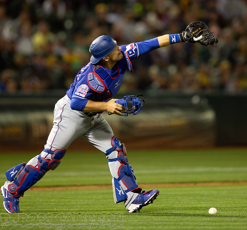 Jul 25, 2019; Oakland, CA, USA; Texas Rangers catcher Tim Federowicz (50) drops a popup off the bat of Oakland Athletics Matt Olson during the sixth inning of a baseball game at Oakland Coliseum. Olson was safe at second base on the error. Mandatory Credit: D. Ross Cameron-USA TODAY Sports