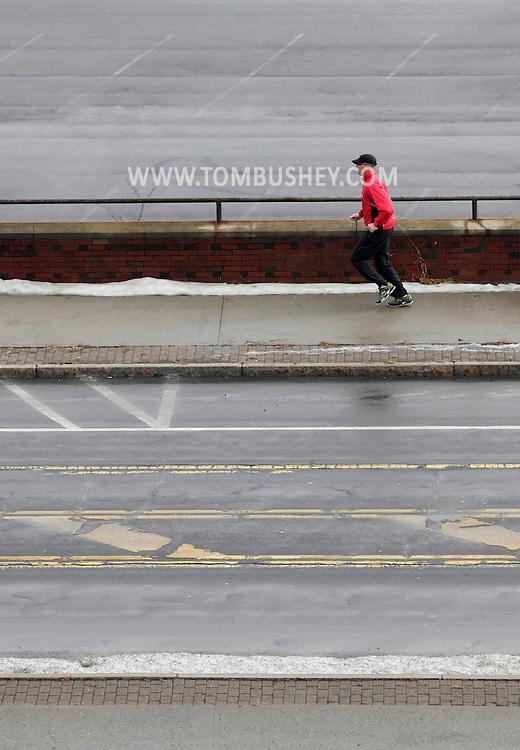 Newburgh, New York - A man runs on the sidewalk on a winter morning on Jan. 2, 2011.