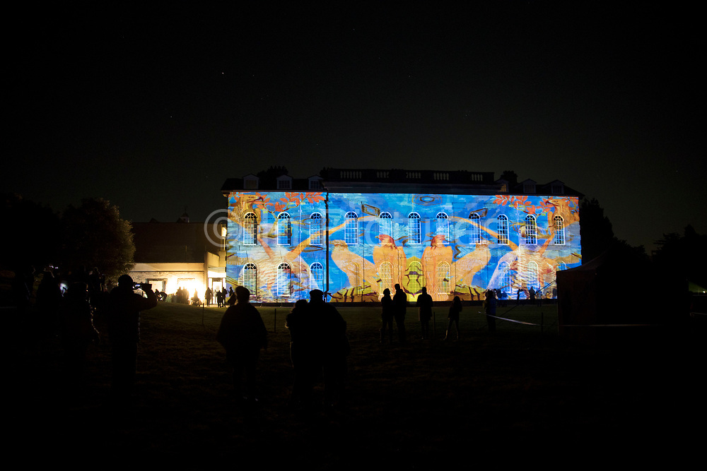 Contemporary light projection onto the exterior of Compton Verney country mansion by light artist Luxmuralis. The light and sound display draws on poetry and nature in a series of light projections onto Compton Verney's Georgian facade with flora and fauna depicted on a miniature and epic scale in Kineton, United Kingdom. Compton Verney House is an 18th-century country mansion at Compton Verney near Kineton in Warwickshire, England, which has been converted to house the Compton Verney Art Gallery. The building is a Grade I listed house built in 1714 by Richard Verney, 11th Baron Willoughby de Broke.