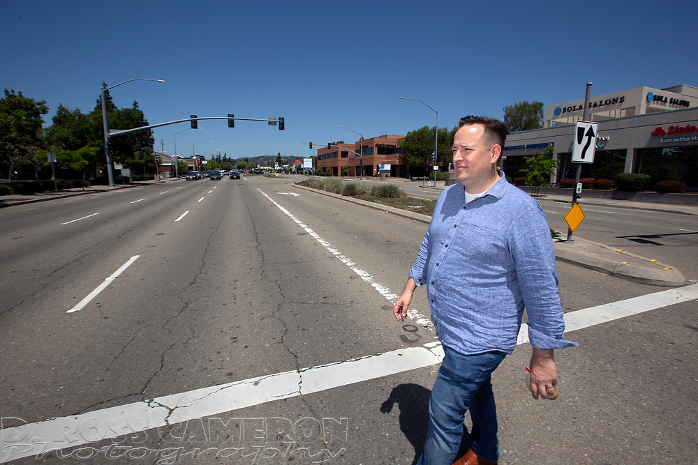 Mike Kusiak of Castro Valley, Calif. crosses Redwood Road near the BART station, Saturday, May 11, 2019 in Castro Valley. Kusiak is seeking to have the Alameda County city incorporated. (Photo by D. Ross Cameron)