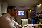 Roma activist Marius Tudor sitting in the kitchen of his mother in law located in Marginenii de Jos.