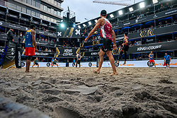 Supporters are safely separated from each other in their own VIP box during the first day of the beach volleyball event King of the Court on Jaarbeursplein. On the field Jasper Bouter (r) and Ruben Penninga.