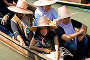 Women in a boat visiting the Damnern Saduak floating market, Bangkok, Thailand