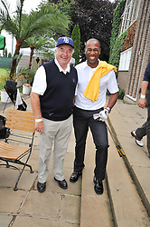 Left to right, comedian JIMMY TARBUCK and footballer LES FERDINAND at the Mini Masters Golf tournament in aid of LEUKA - London's celebrity golf tournament held at Duke's Meadow Golf Club, Dan Mason Drive, London W4 on 17th July 2009.