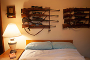 Hunter Byron Grubbs home is full of the guns, trophies, stuffed animals and hunting paraphernalia of an experienced hunter, Burlington near Minot, North Dakota, United States. Here, his gun room serves as a guests bedroom.