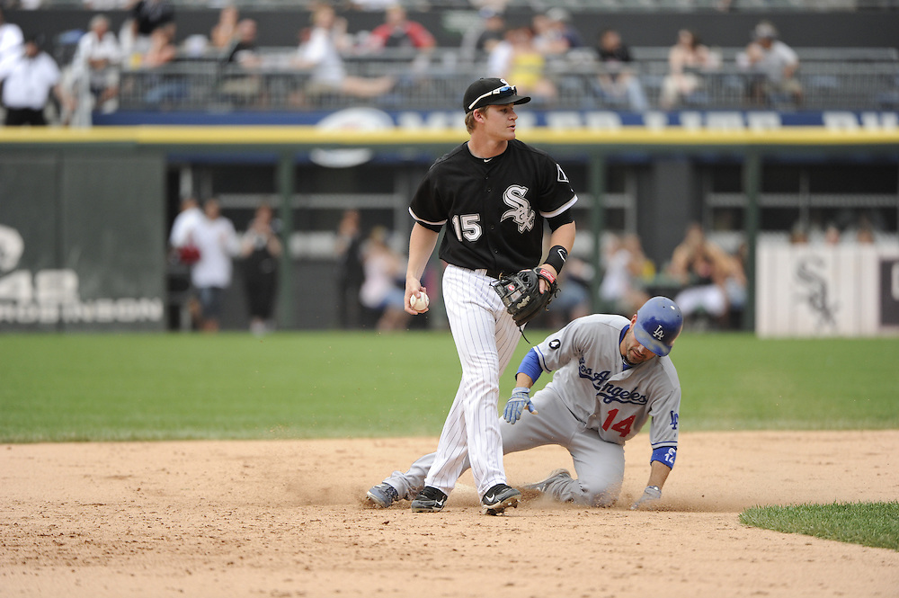 CHICAGO - MAY 22:  Gordon Beckham #15 of the Chicago White Sox makes a force out at second base as Jamey Carroll #14 of the Los Angeles Dodgers slides in late on May 22, 2011 at U.S. Cellular Field in Chicago, Illinois.  The White Sox defeated the Dodgers 8-3.  (Photo by Ron Vesely)  Subject:   Gordon Beckham;Jamey Carroll