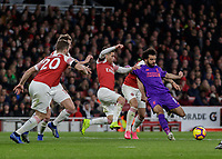 Football - 2018 / 2019 Premier League - Arsenal vs. Liverpool<br /> <br /> Mohamed Salah (Liverpool FC) prepares to shoot surrounded by Arsenal players at The Emirates.<br /> <br /> COLORSPORT/DANIEL BEARHAM